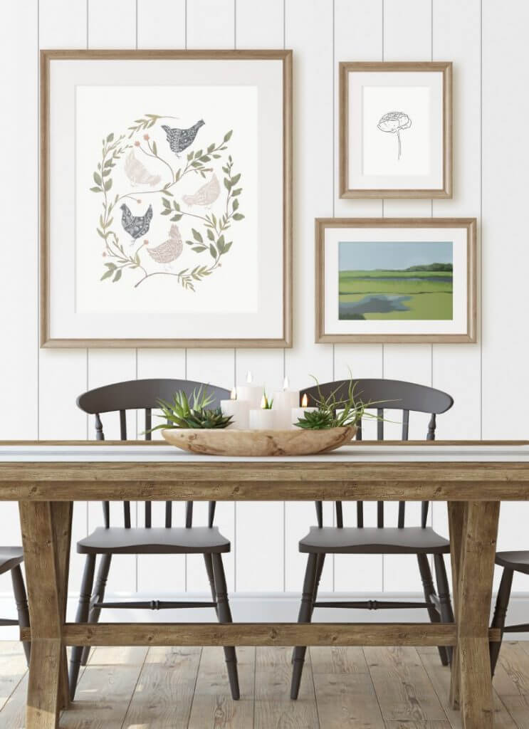 Farmhouse dining table with black chairs and a farmhouse style gallery wall with my FREE chicken printable!