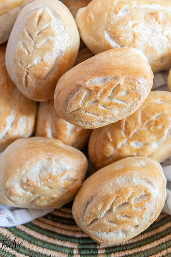 Up your fall game by serving these gorgeous fall inspired dinner rolls with a leaf cut design! This only takes about 5 minutes and you can use frozen pre-made dough or your own favorite dinner roll recipe to make them! You only need one special tool to do it!